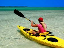 A Fat Camp guest in a kayak in beautiful Madeira Beach