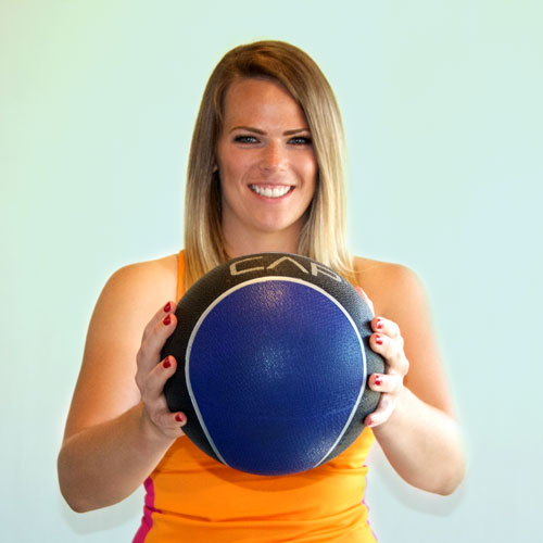 The lead trainer at Weight Crafters holds a medicine ball