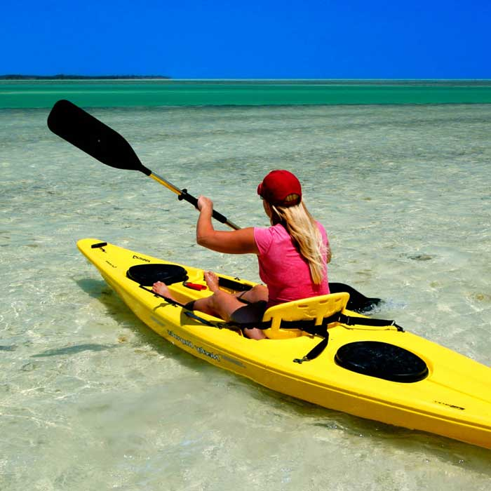 A young weight loss program client kayaking off the Gulf Coast at Weight Crafters