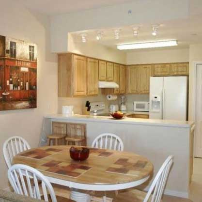the kitchen and dining area in a condo at Weight Crafters