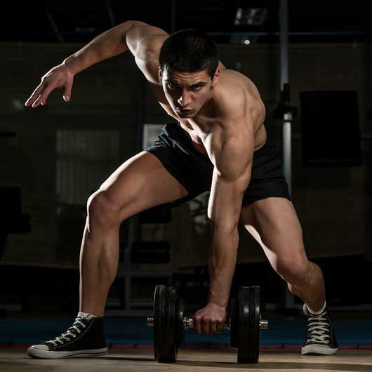 a man prepares to lift a weight