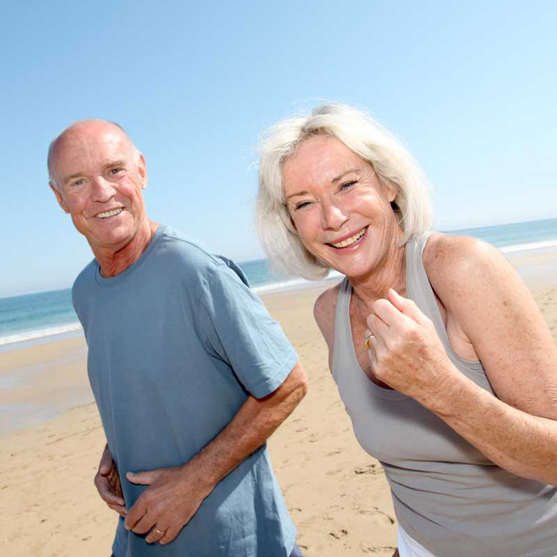 A senior woman and her husband enjoys activity on the beach during their weight loss camp stay at Weight Crafters