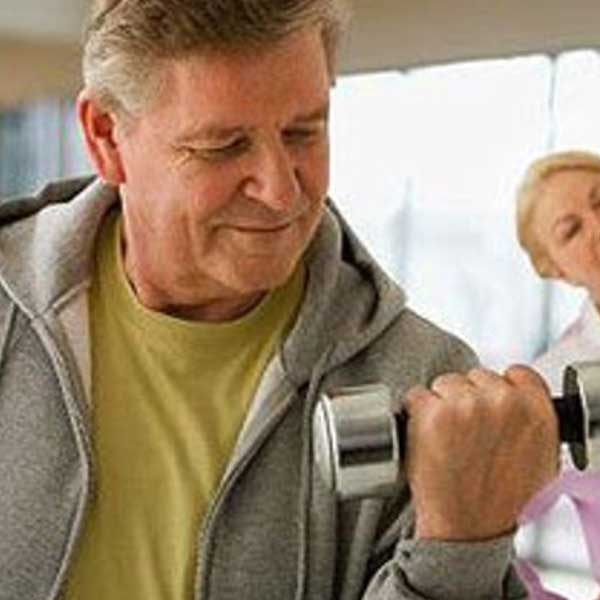 An older male fat camp client does strength training at Weight Crafters