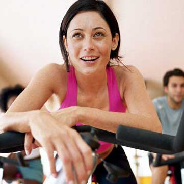 A young woman on a spin bike