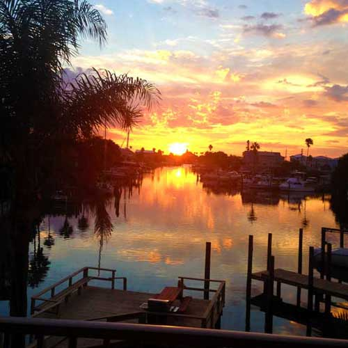 a stunning sunrise over Madeira Beach at Weight Crafters