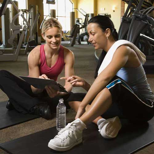 Certified weight loss program trainers discuss a plan