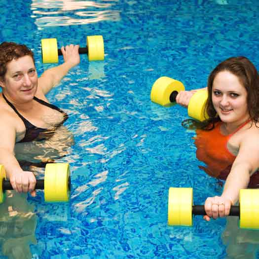 Weight loss camp clients doing low impact water exercises at Weight Crafters.