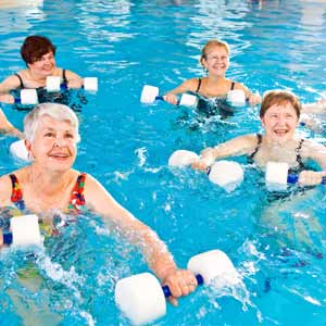 a group of seniors engaged in water aerobics