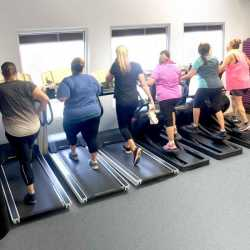 A group of weight loss camp clients doing some morning cardio at Weight Crafters.
