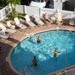 Happy weight loss camp clients enjoying a fun afternoon workout session in the pool at Weight Crafters.