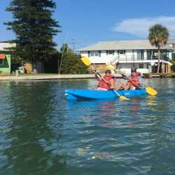 Weight loss retreat clients enjoying a brisk kayaking trip at Weight Crafters