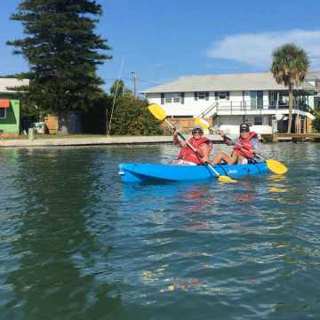 A happy couple kayaking at Weight Crafters